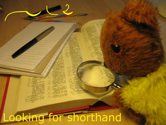 Yellow Teddy looking for shorthand in the dictionary